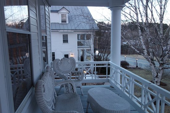 Saint Johnsbury, VT: The porch in front of our room looking over at the main building.