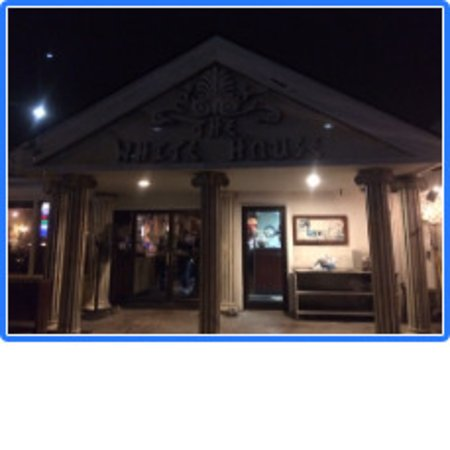 Post Falls, ID: White House Grill front entrance after dark