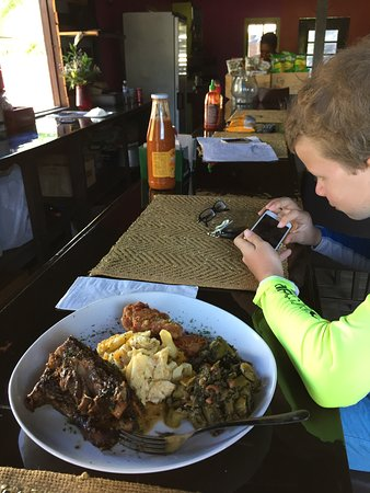 Spanish Town, Virgin Gorda: My son plays some videos before we devour our shared lunch plate...
