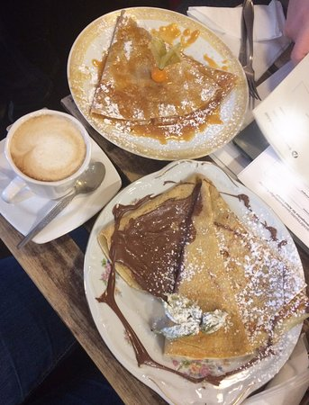 Cafe Creperie Melt: Cappucino, Nutella crepe (bottom), Homemade caramel crepe (top)