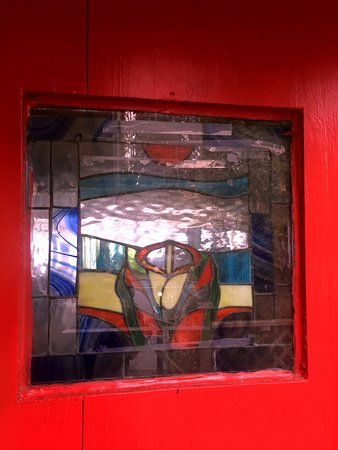 Red stained glass front door, Beach House Cafe, 2775 Island Hwy, Qualicum Beach,