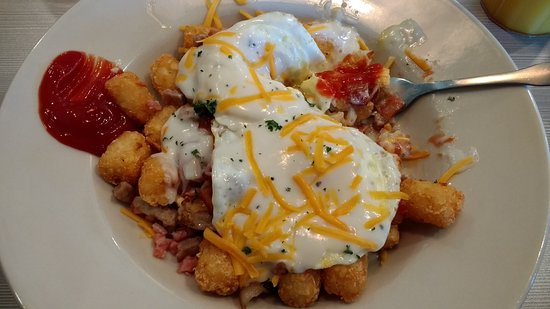 Urbana, IL: A breakfast smash, tater tots under bacon, sausage, scrambled eggs, cheese, and a bit of gravy
