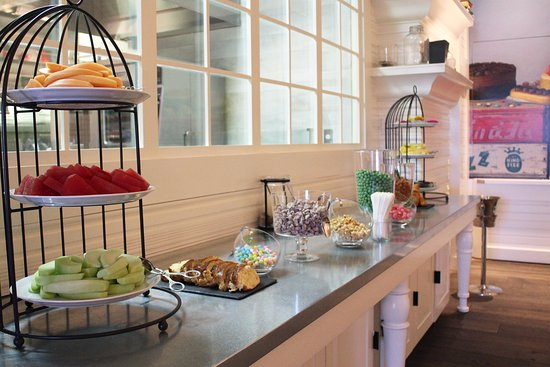 The Brunch Dessert Display Emulates The Wall Mural With