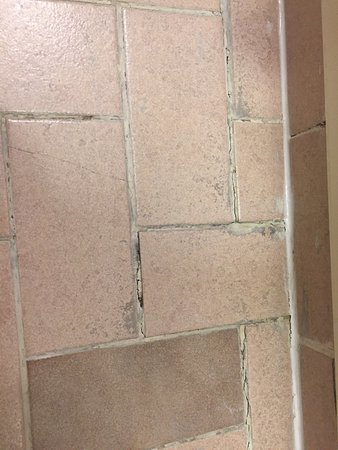 Bathroom Tiles Loose marks in bath,loose floor tiles in bathroom,discoloured bath mat