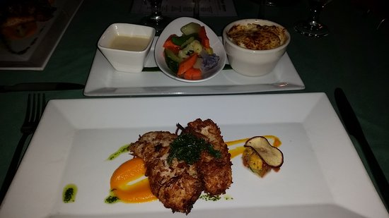 Rainforest Hideaway: Coconut crusted lionfish with potato gratin, sauted vegetables and ginger sauce