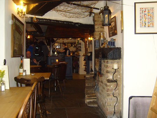Amberley, UK: A welcome as warm as the log fire blazing in the hearth greets visitors to the Bridge Inn @ Ambe