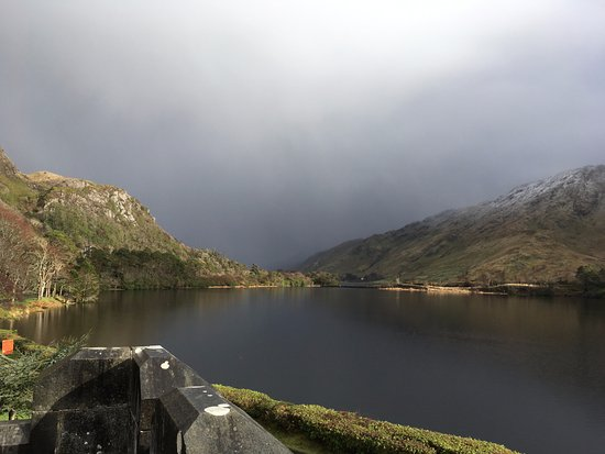 Kylemore, Ireland: Snow moving through the valley. View of the lake from the front of the Abbey