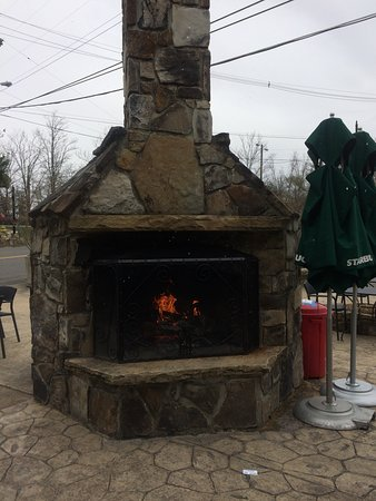 Starbucks: The outdoor fireplace as viewed from the seating inside