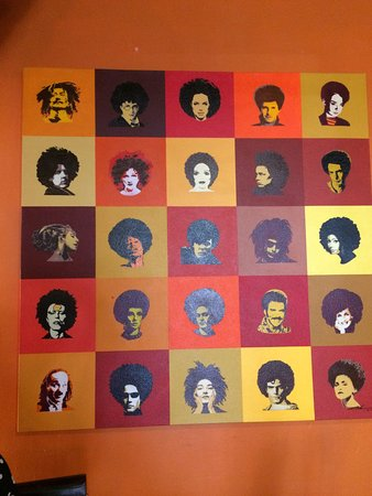 Ikhaya Lodge: Art on the dining room wall. Can you identify these celebrities with African hairstyles?