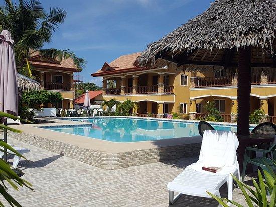 Slam's Garden Resort: Zona piscina/bar nelle ore diurne