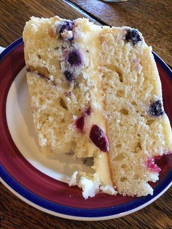Landrum, ساوث كارولينا: Lemon-berry mascarpone cake ... with one bite missing.
