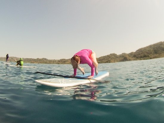 Mal Pais Freedom Riding SUP: Sometimes we do yoga on the boards which is a really fun balancing act!