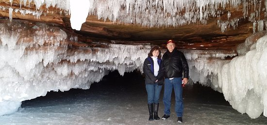 My wife and I standing on Lake Superior under an ice cave!
