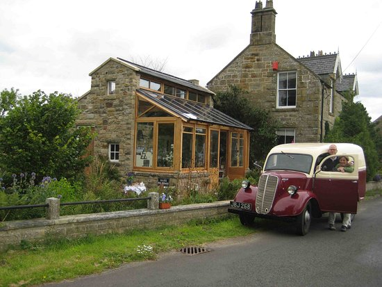 West Woodburn, UK: Gerard and Jeanette in front of the Slate and Nature studio, with their Fordson Van.