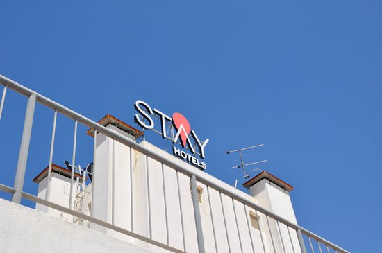 Stay Hotel sign