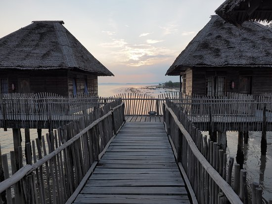 Telunas Resorts - Telunas Beach Resort: Sunset and chalet C7 (left) and C8 (right) during low tide