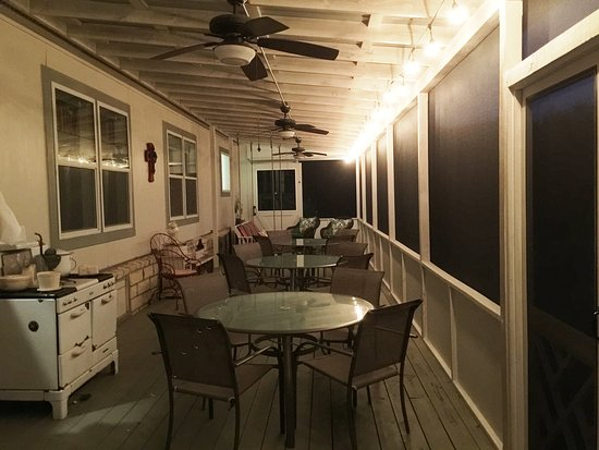 Wimberley, TX: Evening on the Screened Porch - porch swing is at the far end.