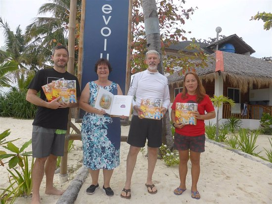Evolution Diving Resort: donation to community program with owner and staff