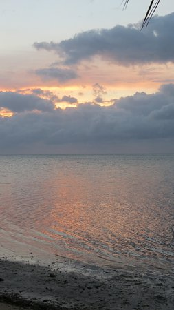 The Moorings Village and Spa: A beautiful, albeit cloudy sunrise.