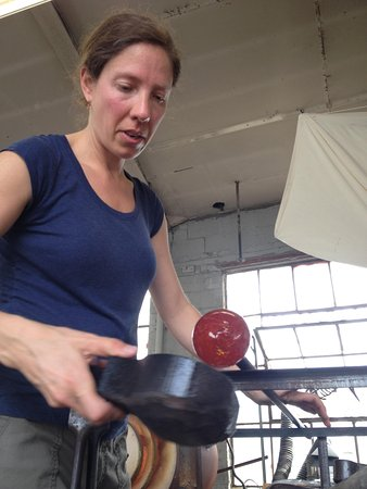 Wakefield, RI: Jen shapes a small ball of glass, preparing it to be blown.