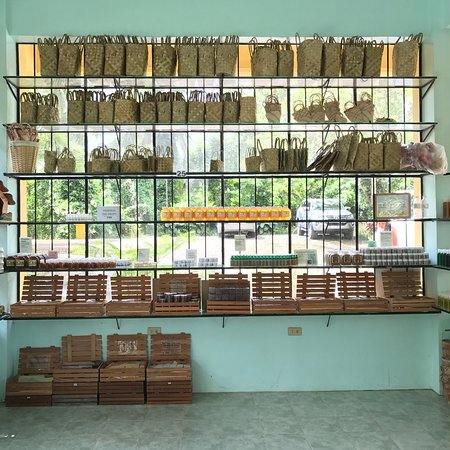 Luzon, Philippines: Beehives in the meadow, front window of the farm store, and interior of the bathroom