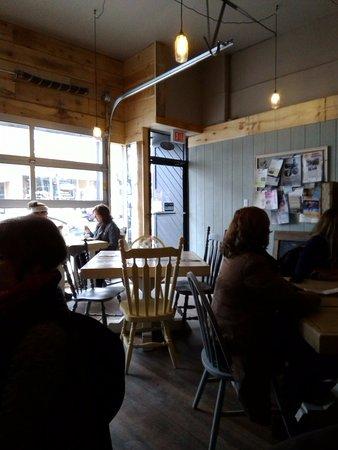Shine Juice Bar Cafe Front Seating Area Showing Garage Door