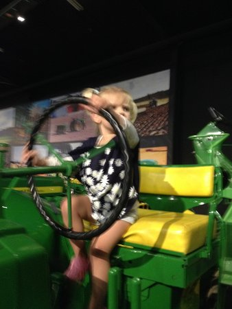 Feilding, New Zealand: little one clambering over large tractors