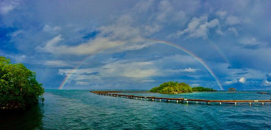 Sandy Bay, Honduras: Double rainbow photo we took at the end of our dock!
