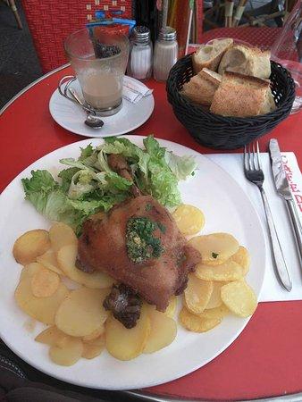 Photo of French Restaurant le cafe du marche at 38 Rue Cler, Paris 75007, France