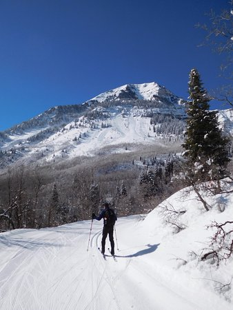 Sundance, UT: view of trail with tracks and corduroy and scenic background