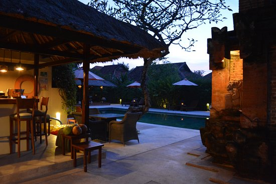 The Pavilions Bali: The pool and bar at dusk