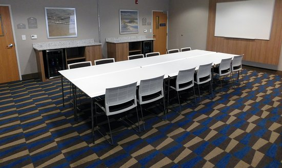 "Microtel Inn & Suites by Wyndham Port Charlotte: Conference Room.  ""Conference"" set up, seating accommodating up to 12."