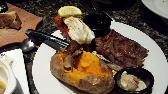 Centennial, CO: Steak and lobster tail, looks yummy, but tail not cooked through