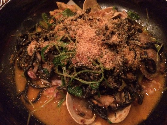 Hillsborough, NC: Squid ink pasta with squid, clams, lobster in a briny, saffron broth