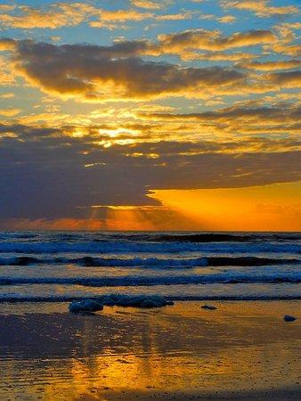 La Fiesta Ocean Inn & Suites: Sunrise from the beach behind Hotel, you have miles of beach