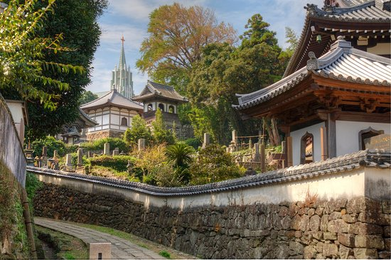 Nagasaki Prefecture, Japan: View of a Christian church and Buddhist temples in Hirado