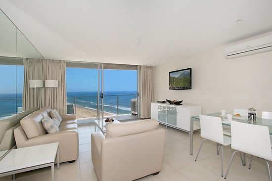 One The Esplanade: Lounge / dining area of one bedroom apartment with fantastic views