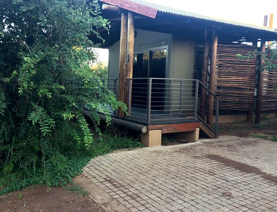 Lower Sabie Restcamp: view from exterior - patio, entrance and parking visible