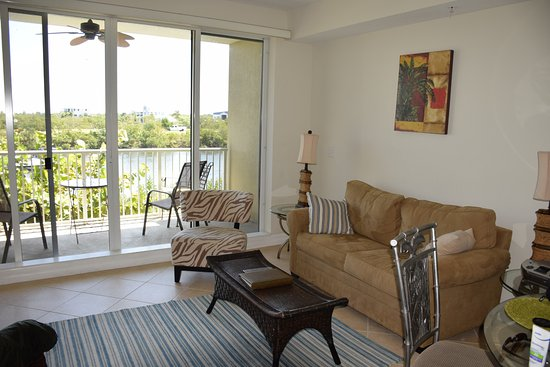 Ruskin, FL: lilving room with balcony on canal side