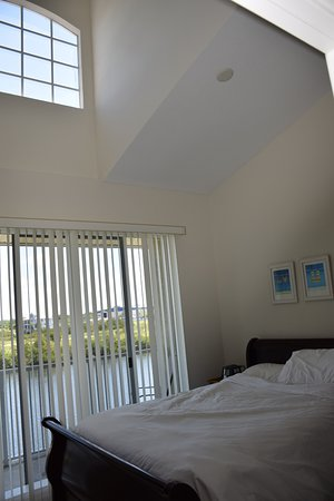 Ruskin, FL: Queen bedroom, 2nd floor, canal view with balcony. TV. Very bright