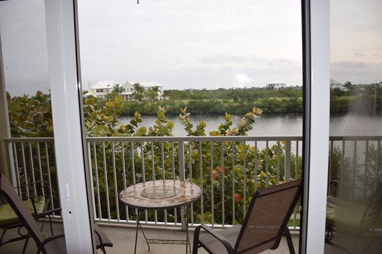 Ruskin, FL: living room balcony overlooking canal. New houses being built across canal.