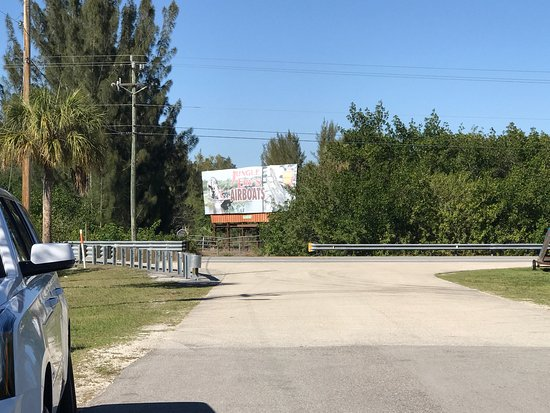 Jungle Erv's Everglades Airboat Tours: billboard sign across from their entrance