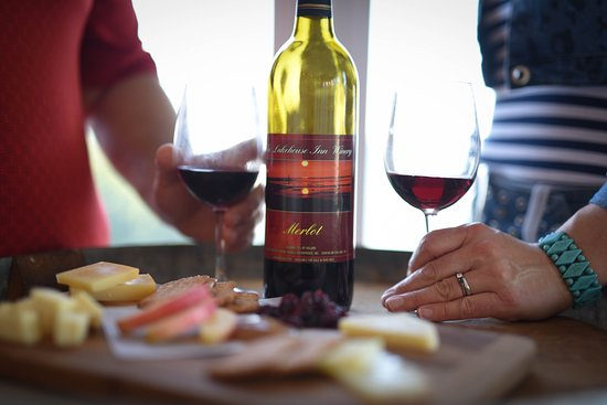 The Lakehouse Inn: Guests enjoying a bottle of wine & cheese board from the onsite winery