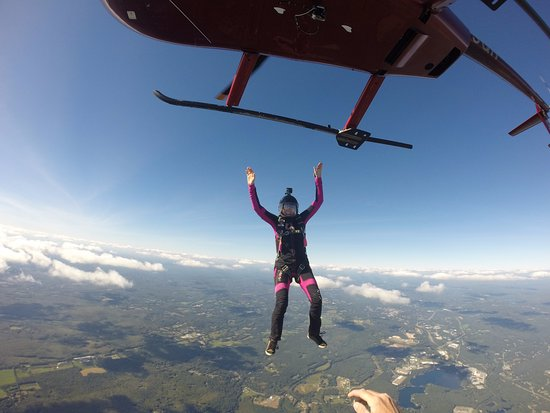 Killingly, CT: Licensed skydiver exits helicopter at Skydive Danielson