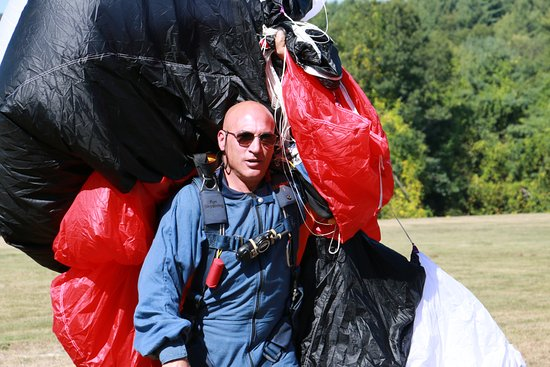 Killingly, CT: Licensed skydiver walking off the field