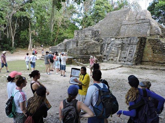 Distrito de Belice, Belice: Guide Antonio Reyes explains the function of a Mayan structure at Lamanai.