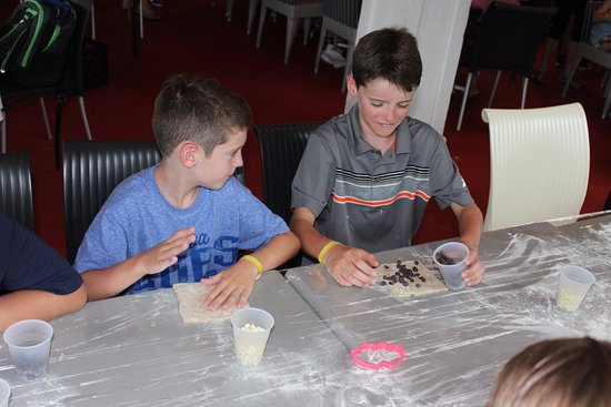 Port Saint Lucie, FL: Making cookies at the kids' camp
