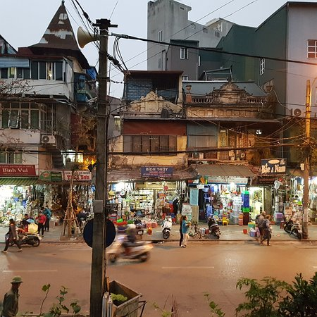 Hanoi Urban Adventures: Businesses still in action as we walk the railway track to BBQ