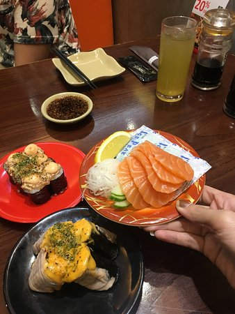 Sushi Tei: fresh salmon sashimi , one plate is never enough ! the bad part is there's seldom have creditcar