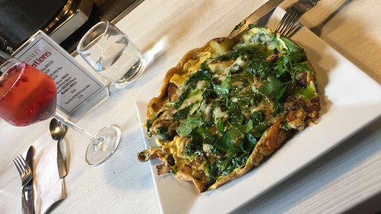 Downtown Market Company: Spinach and mushroom frittata with potatoes, garlic, onions, Swiss, and basil